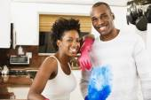African American couple with cleaning tools — Stockfoto