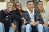 African men sitting on porch steps — Stock Photo