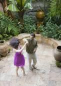 Multi-ethnic couple dancing on patio — Stock Photo