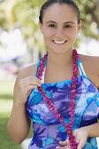 Hispanic woman wearing bathing suit — Stock Photo