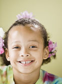Close up of Mixed Race girl smiling — Stock Photo