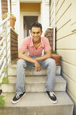 Indian man sitting on steps — Stock Photo