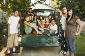Teenagers and young adults in back of truck — Stock Photo