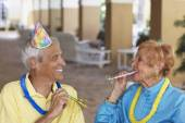 Senior couple at birthday party — Stock Photo