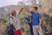 Multi-ethnic men on golf course — Stock Photo