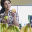 Mixed Race woman choosing apples at grocery store — Stock Photo #52080197