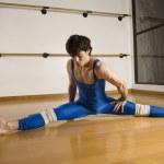 Hispanic male dancer doing split — Stock Photo #52080221