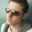 Young man wearing sunglasses — Stock Photo