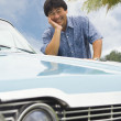 Asian man leaning on car — Stock Photo #52081323