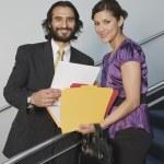 Hispanic businesspeople holding folders — Stock Photo #52081399