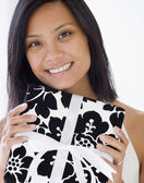 Pacific Islander woman holding gift — Stock Photo