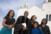 African American Reverend and family — Stock Photo