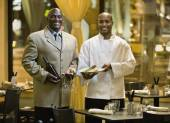 African male restaurant staff — Stock Photo