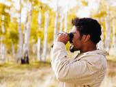 African man looking through binoculars — Stock Photo