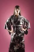 Middle Eastern woman wearing silk robe — Stock Photo
