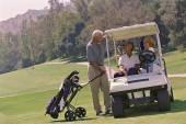Multi-ethnic seniors on golf course — Stock Photo