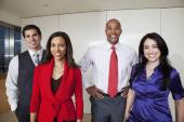 Business people smiling — Stock Photo