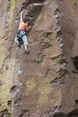 Asian woman rock climbing — Stock Photo