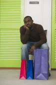 African man waiting outside dressing rooms — Photo