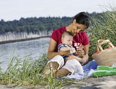 Mixed Race mother and baby at beach — Stock Photo