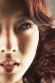 Asian woman looking sideways — Stock Photo