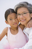 Asian mother and daughter in ballet outfit hugging — Stock Photo