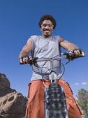 African man on mountain bike — Stock Photo
