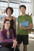 Multi-ethnic business owners in exercise studio — Stock Photo