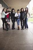 Students in school corridor — Stock Photo