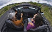 Mother and adult daughter in convertible car — Stock Photo