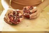 Asian woman holding pomegranate — Stock Photo
