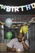 Senior African American male worker with birthday cupcake — Foto Stock