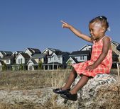 African American girl pointing — Stock Photo