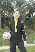 Hispanic girl holding ball — Stock Photo