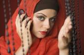 Middle Eastern woman talking on cell phone — Stock Photo