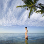 Pacific Islander woman standing in ocean — Foto de Stock