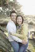 Asian couple hugging — Stock Photo