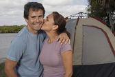 Hispanic couple in front of tent — Foto de Stock