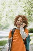 Mixed Race boy talking on cell phone — Stock Photo