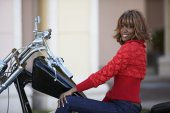 African woman on motorcycle — Foto Stock