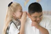Multi-ethnic children telling secret — Stock Photo