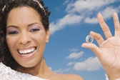 Hispanic bride holding ring — Stock Photo