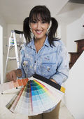 Middle Eastern woman holding paint swatches — Stock Photo