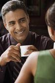 Hispanic man smiling at wife — Stock Photo