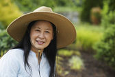 Senior Asian woman wearing hat — Stockfoto