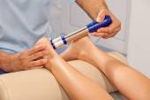 Doctor orthopedist making Shock wave therapy — Stok fotoğraf