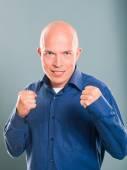 Handsome bald  man wearing blue skirt — Photo