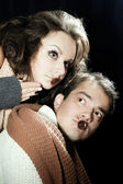 Mężczyzna i kobieta ubrana jak wampir i czarownica. halloween — Zdjęcie stockowe