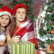 Beautiful girl holding gifts. Christmas — Stock Photo #58807313