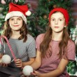 Two girl wearing santa hat — Stock Photo #58807321